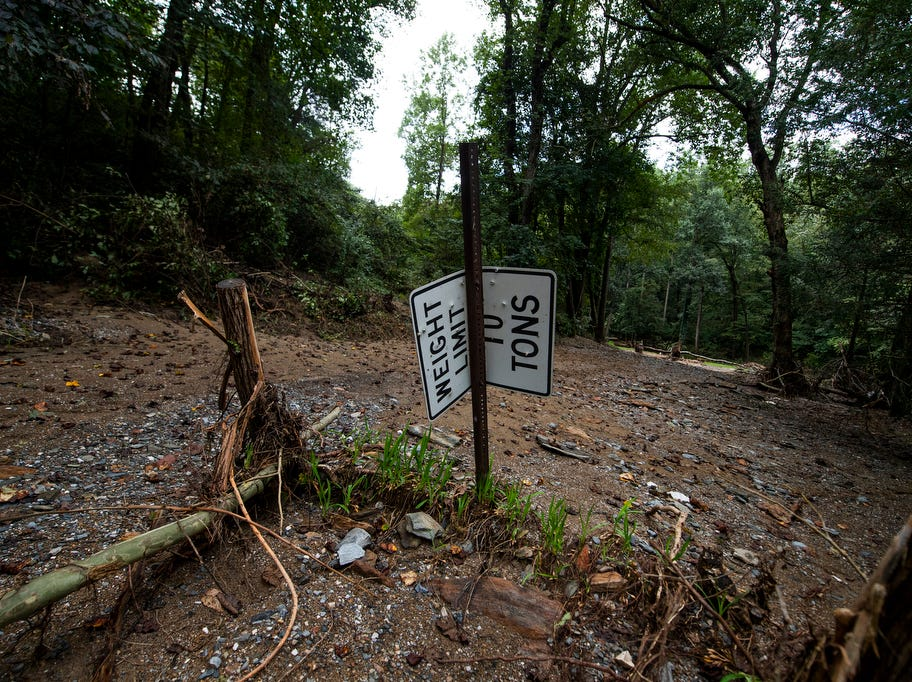 A bent road sign is seen where a road used to take visitors back to Donnie Grove's house, which was washed away, Thursday, September 13, 2018. Flooding that occurred Aug. 31 ripped houses from foundations, moved boats into yards and destroyed roads and bridges in Chanceford Township.