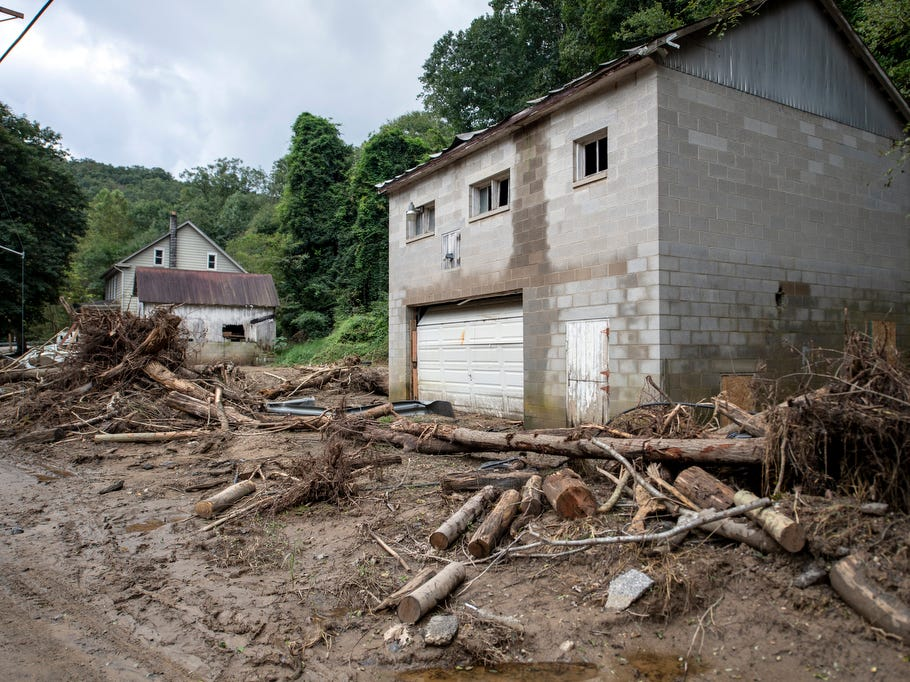 Downed tress rest in front of a garage, Thursday, September 13, 2018. Flooding that occurred Aug. 31 ripped houses from foundations, moved boats into yards and destroyed roads and bridges in Chanceford Township.