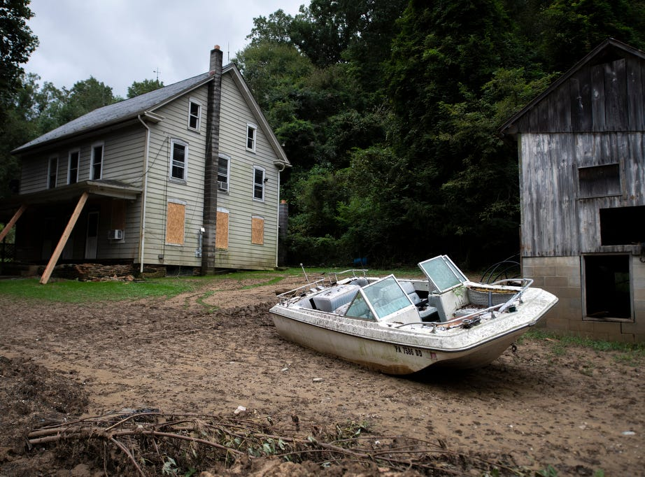 A boat sits in a yard of a house that, neighbors say, had to be evacuated in Chance Township, Thursday, September 13, 2018. Flooding that occurred Aug. 31 ripped houses from foundations, moved boats into yards and destroyed roads and bridges in Chanceford Township.