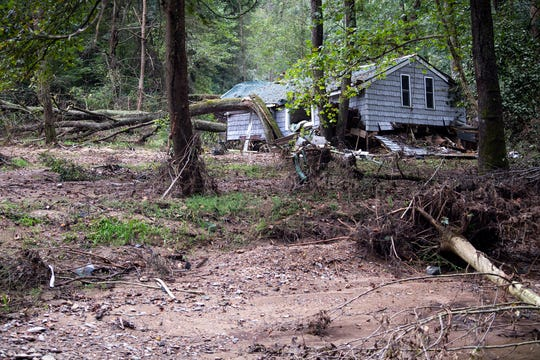 A house, destroyed by the Aug. 31 flooding, sits along the bank of Otter Creek, some of the millions of dollars worth of damage caused by the flash flood.