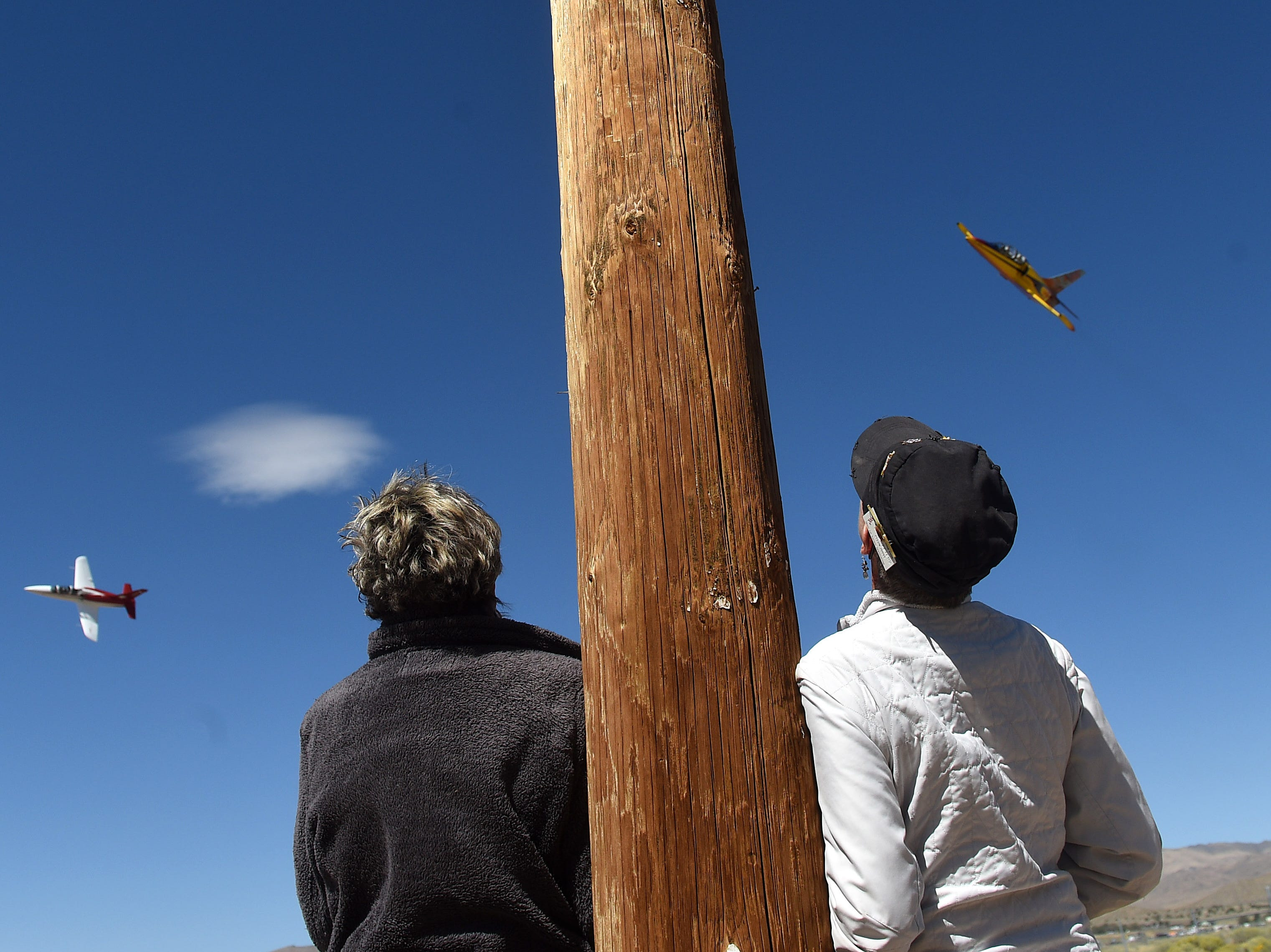 Pylon 7 judges Kathy Kibby, left, and Sandy Peters keep an eye on the planes to make sure they stay to the outside of the pylon during the STIHL National Championship Air Races at Stead Airport north of Reno on Sept. 13, 2018.