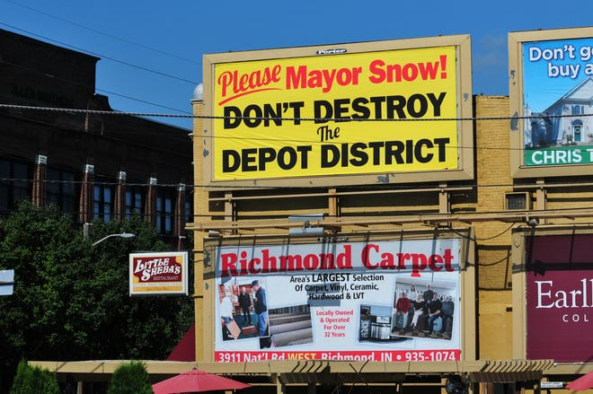 Signs have gone up in Richmond's Historic Depot District ahead of a public hearing on an ordinance aimed at slowing down plans for building a path pike through the area.