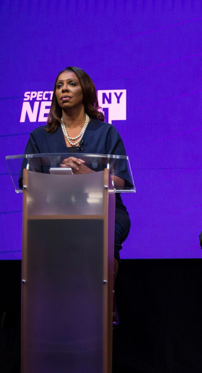 FILE- In this Aug. 28, 2018, file photo, Democratic Candidates for the office of New York Attorney General take part in a debate at John Jay College of Criminal Justice in the Manhattan borough of New York. From left are Letitia James, Sean Patrick Maloney, Leecia Eve, and Zephyr Teachout.