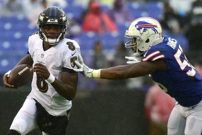 Sep 9, 2018; Baltimore, MD, USA; Baltimore Ravens quarterback Lamar Jackson (8) runs as Buffalo Bills defensive end Jerry Hughes (55) defends during the fourth quarter at M&T Bank Stadium. Baltimore Ravens defeated Buffalo Bills 47-3. Mandatory Credit: Tommy Gilligan-USA TODAY Sports