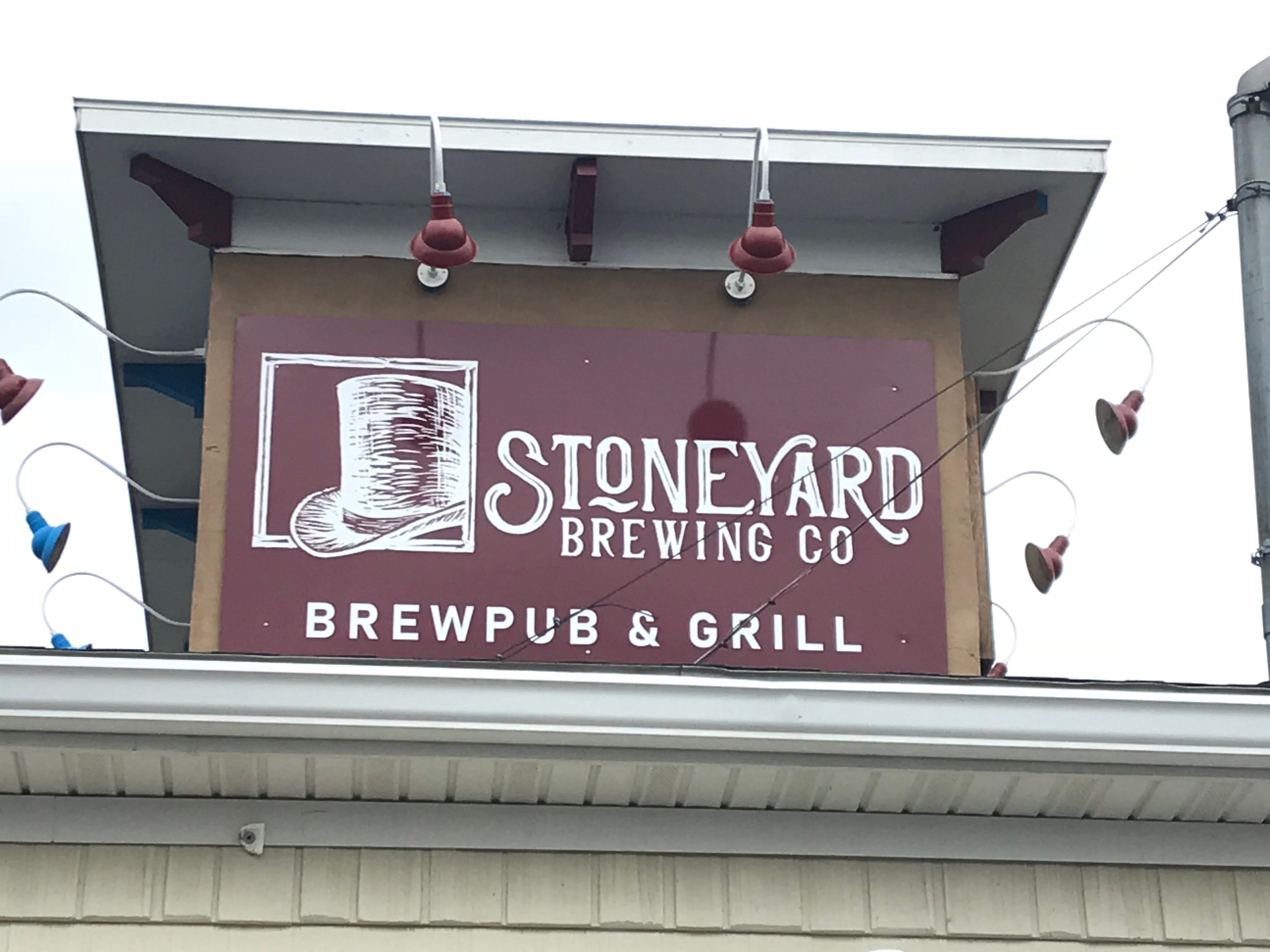 The new Stoneyard logo atop the brewery's brewpub on Merchants Street in Brockport.