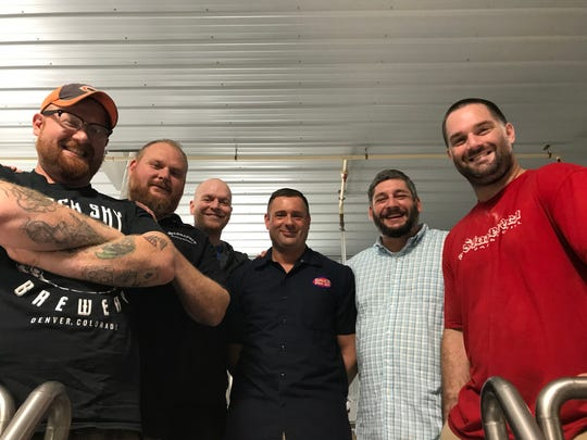 "The Stoneyard Brewing team, from left: assistant brewer James Riley III, owner Jay Nichols, director of social media/bartender Dan Moriarty, owner/director of operations Britton Kolb, director of sales Chirsan Lichtenstein, head brewer/co-owner Jeffrey ""Oz"" Osbourne."