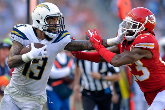 Los Angeles Chargers wide receiver Keenan Allen (13) stiff arms Kansas City Chiefs cornerback Kendall Fuller (23) during the fourth quarter at StubHub Center.