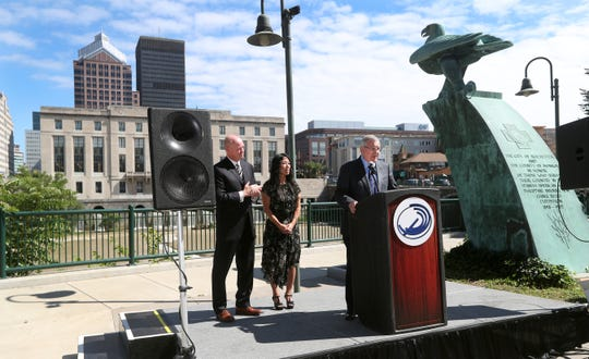 Standing outside the Blue Cross Arena along the Genesee River, Terry Pegula with his wife Kim and Dave Rowan, National Lacrosse League COO, announce that they will be the new owners of the Rochester Knighthawks as an expansion team.  Curt Styres, who has owned the Knighthawks for 10 years, is moving his franchise to Halifax, Nova Scotia.