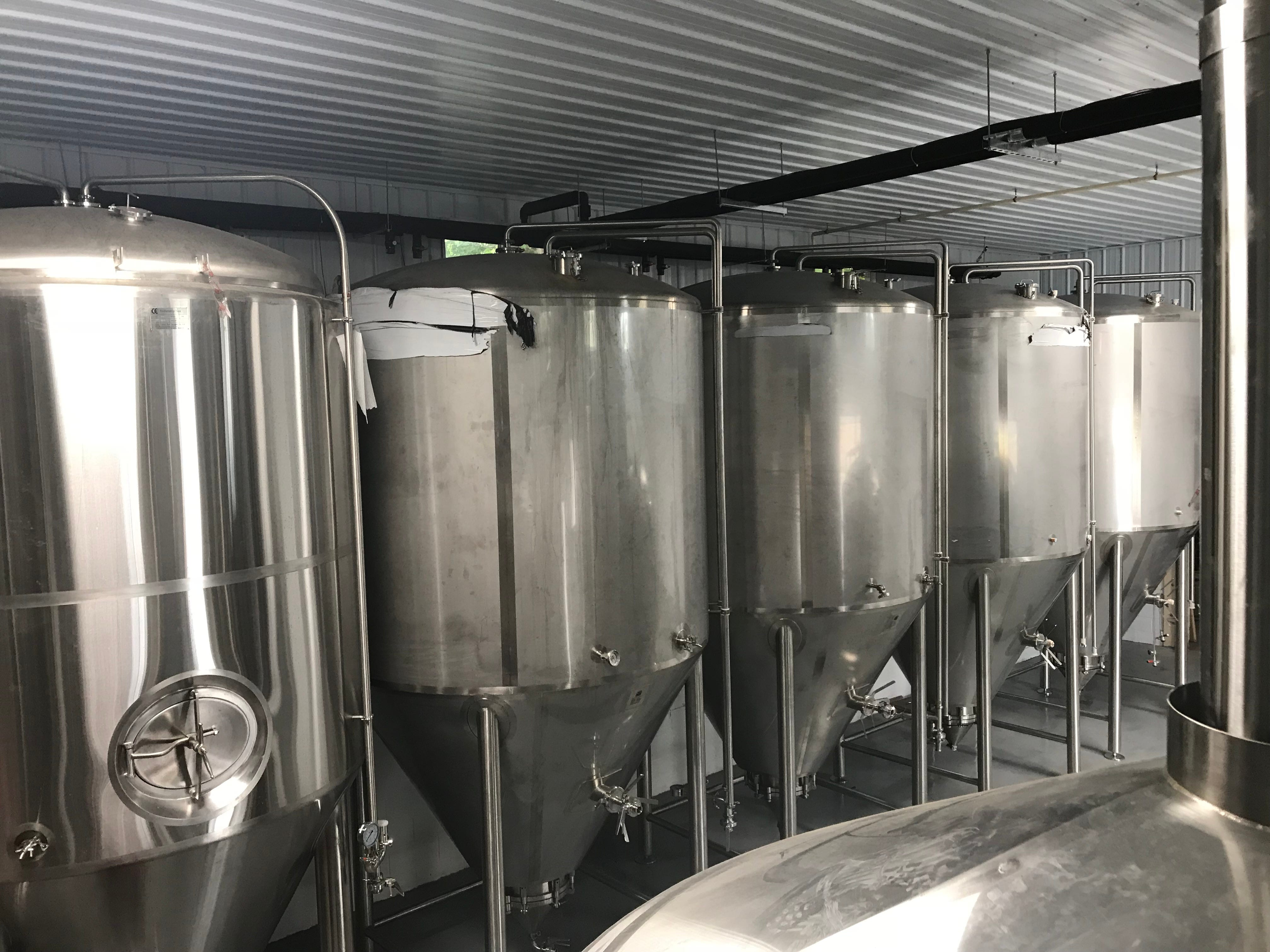 A row of 60-barrel fermenters at Stoneyard Brewing in Brockport.