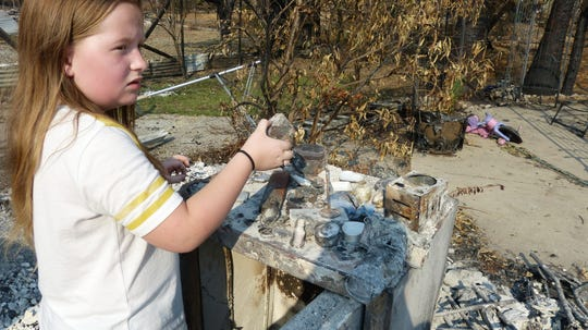 Caoimhe Biehle collected trinkets and placed them on a burned safe at her Lake Keswick Estates home.