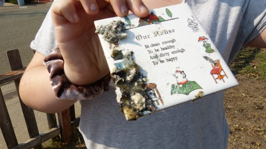 Aoife Biehle found a tile that once was on the wall of her Lake Keswick Estates home.