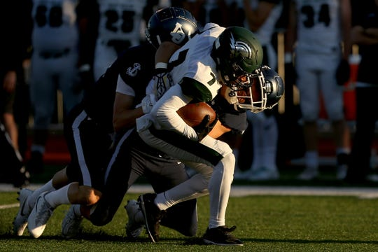West Salem's Stanley Green (7) is taken down by Lake Oswego players in the first half of the Titans' season opener at Lake Oswego High School on Friday, Aug. 31, 2018. West Salem lost 48-21.