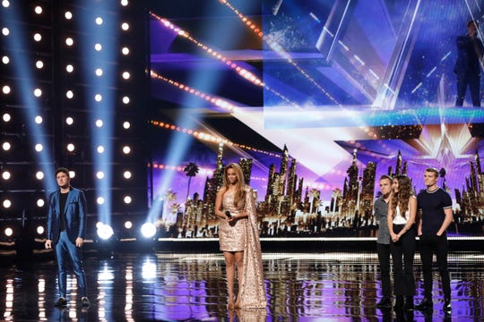 """From left, Daniel Emmet, Tyra Banks and We Three await a decision on who would make it to the next round of """"America's Got Talent."""""""