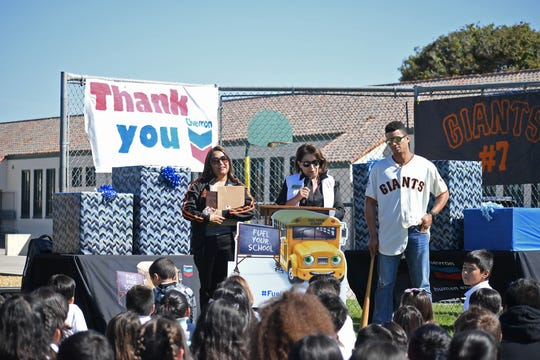 Roosevelt Elementary School principal Hilda Huerta (left), Salinas City Elementary School District Superintendent Martha Martinez (center) and San Francisco Giants center fielder Gorkys Hernandez speak to students about the STEM supplies they received Thursday morning.
