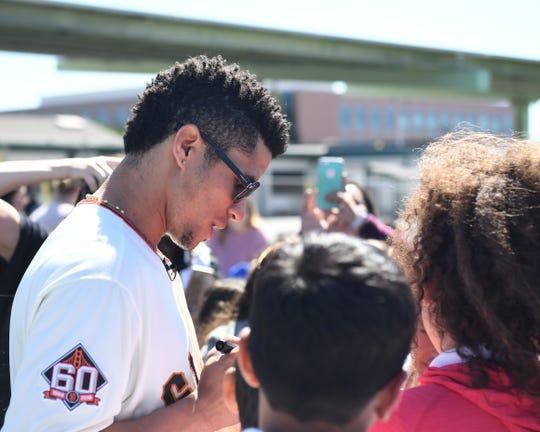 San Francisco Giants center fielder Gorkys Hernandez signs autographs for kids at Roosevelt Elementary school.