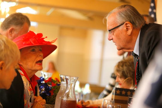 Joan Peak, of Carmel, speaks with Joe Arpaio, former sheriff of Arizona's Maricopa County, during a Monterey Peninsula Republican Women Federated luncheon in Carmel Valley on Sept. 13.
