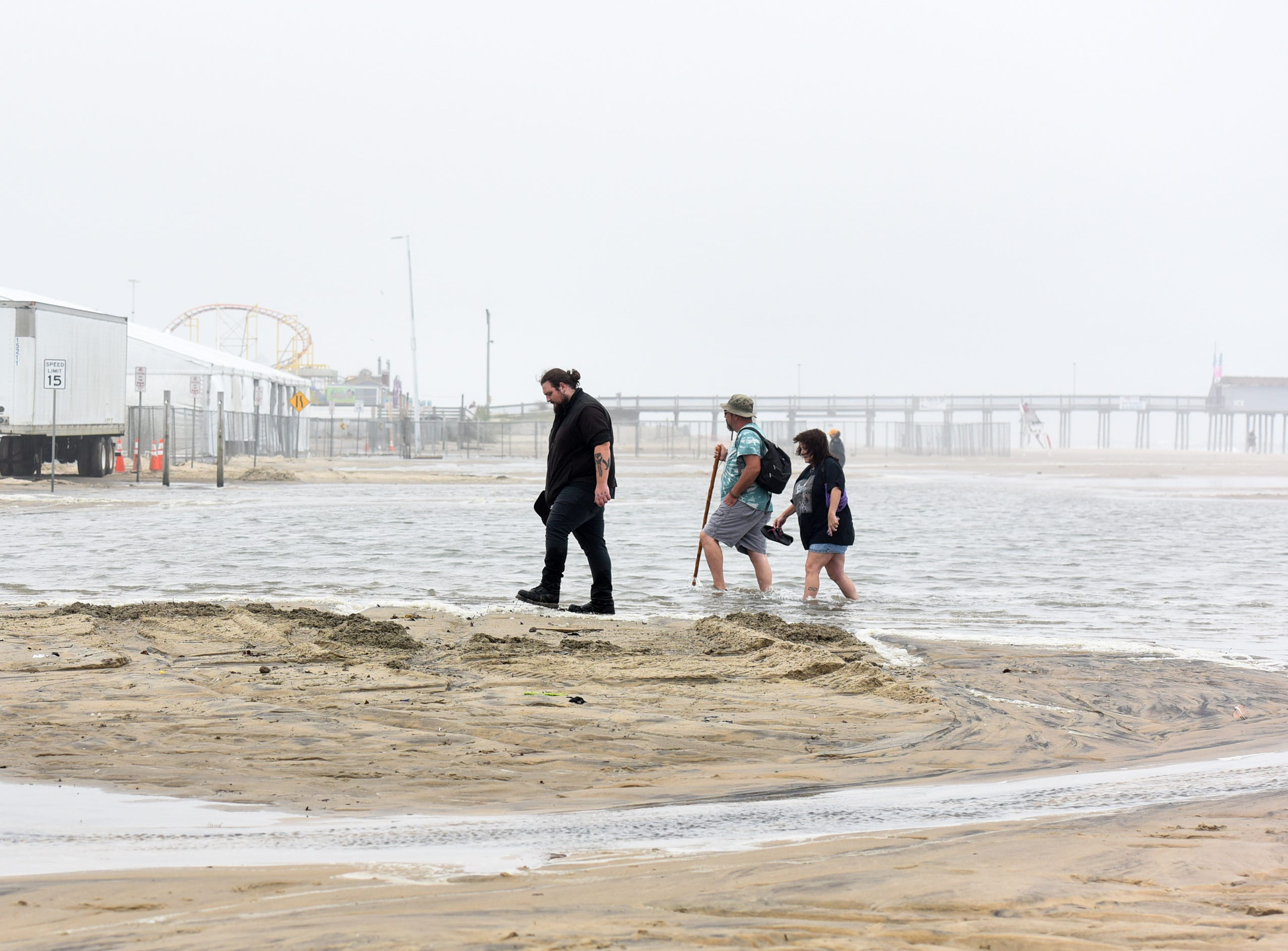 Visitors wade through flooding at the Ocean City inlet on Thursday, Sept 13.