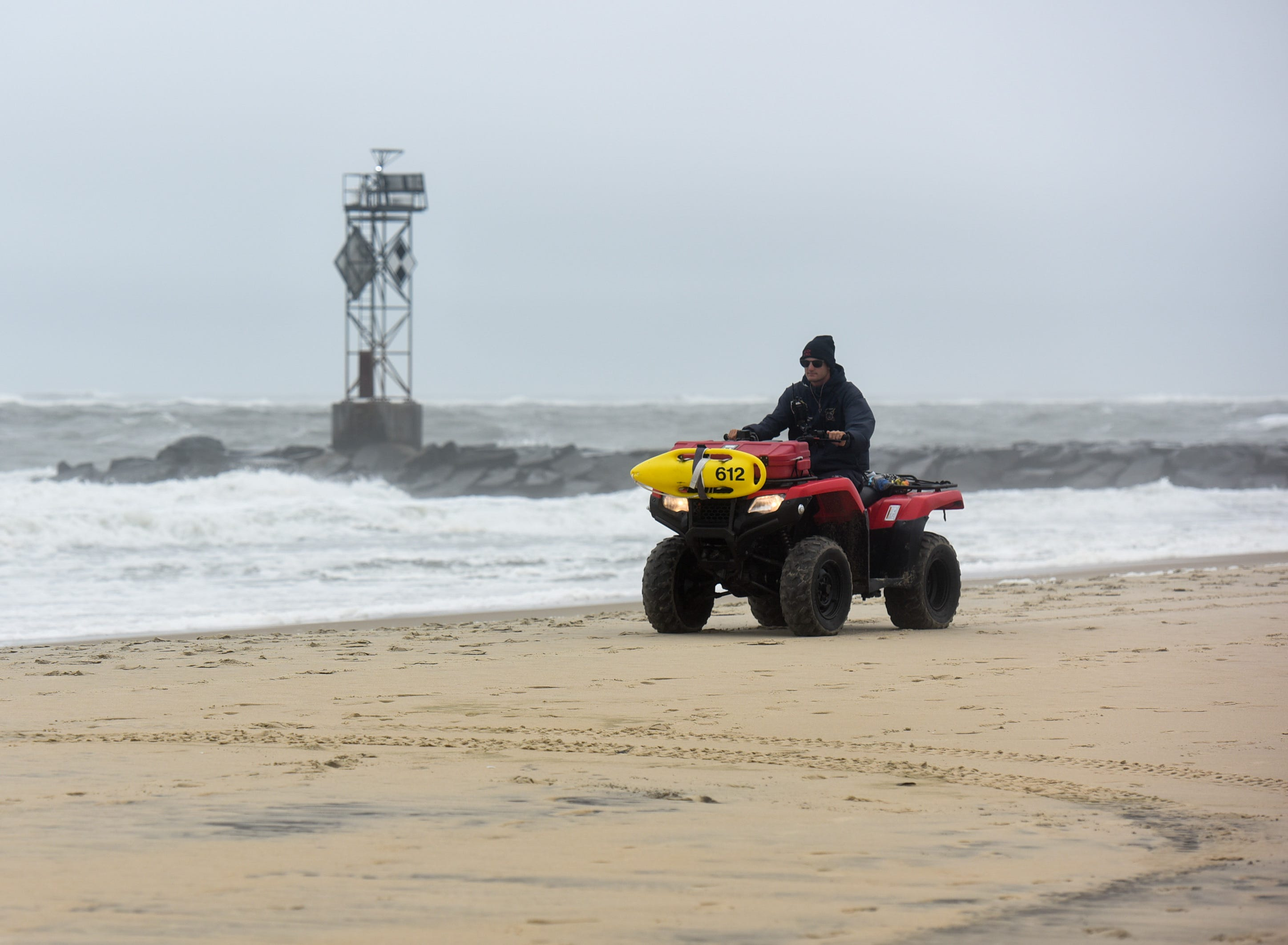 A lifeguard drives across the beach in Ocean City. The area saw mild flooding, wind and rough surf on Thursday, Sept 13.