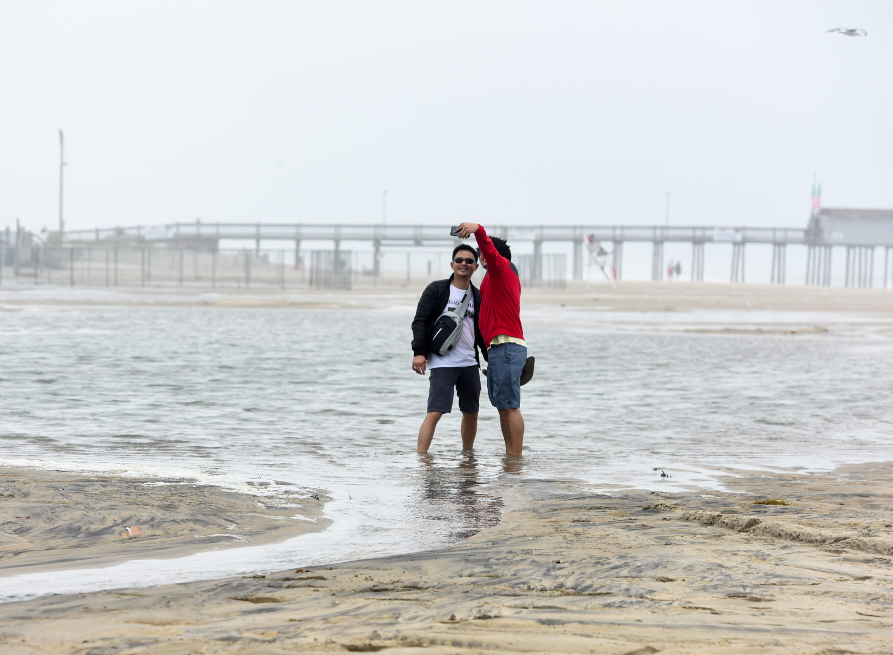 Visitors take a selfie at the Ocean City inlet. The area experienced mild flooding, wind and rough surf on Thursday, Sept 13.