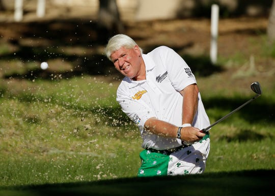 John Daly hits out of a bunker onto the 17th green of the Monterey Peninsula Country Club Shore Course during the second round of the AT&T Pebble Beach National Pro-Am golf tournament Friday, Feb. 13, 2015, in Pebble Beach, Calif. (AP Photo/Eric Risberg)