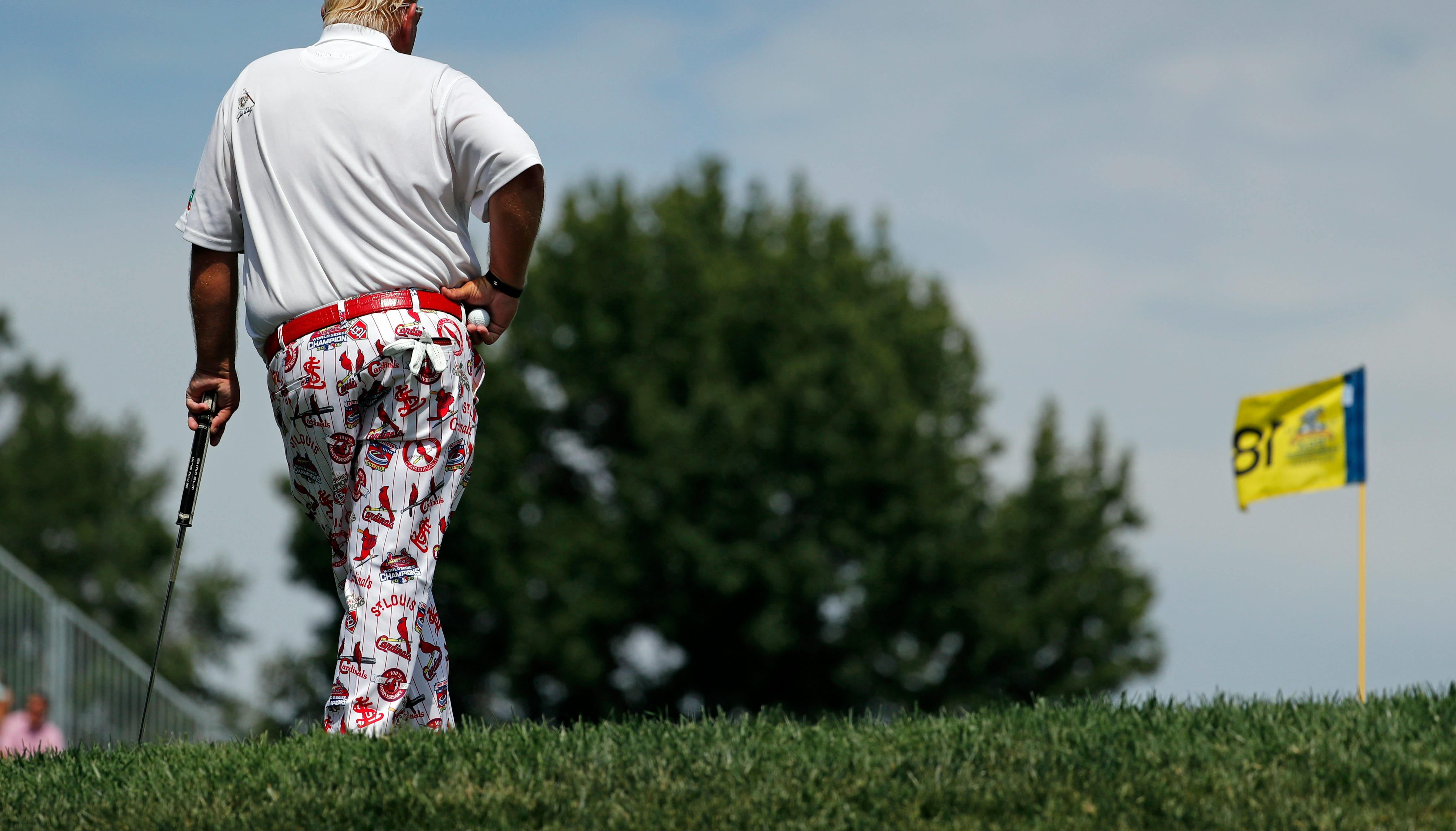 John Daly waits to putt on the 18th green during the first round of the PGA Championship golf tournament at Bellerive Country Club, Thursday, Aug. 9, 2018, in St. Louis. (AP Photo/Jeff Roberson)
