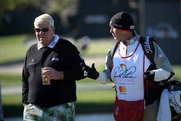 John Daly, left, talks with his caddie on the 17th green during the first round of the Arnold Palmer Invitational golf tournament in Orlando, Fla., Thursday, March 16, 2017. (AP Photo/Phelan M. Ebenhack)