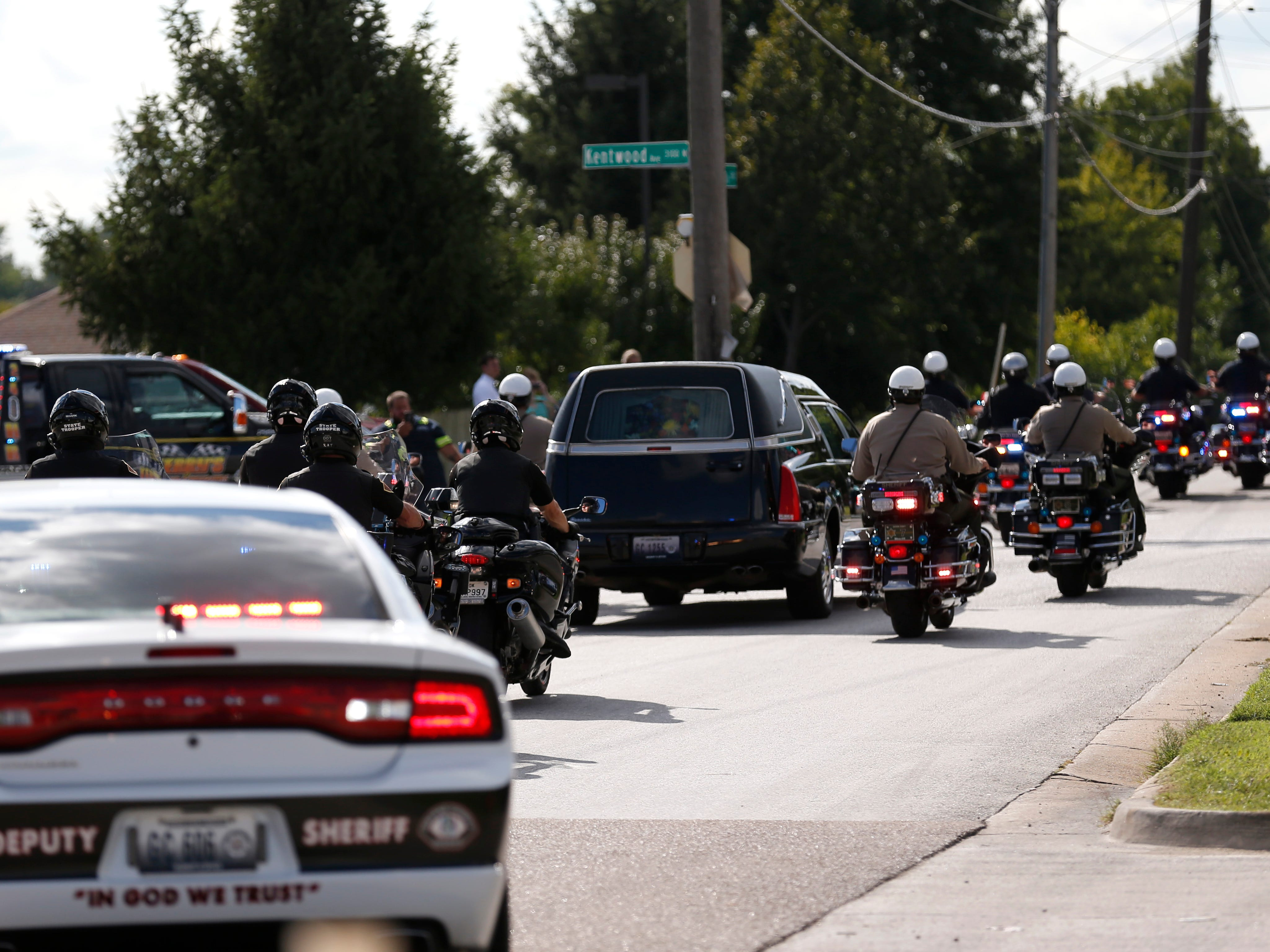 The funeral procession for Deputy Aaron Roberts moves down Glenstone Avenue on Thursday, Sep. 13, 2018.