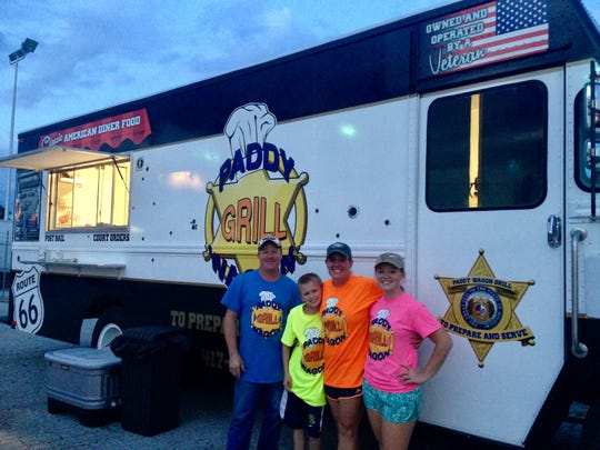 Mark, John, Jennifer and Mikayla Yount stand in front of the Paddy Wagon Grill food truck, which the family owns. The truck closes following a Sept. 14, 2018 food-truck festival. The Younts plan to open a restaurant in Fair Grove, Time Traveler Cafe, on Sept. 29, 2018.