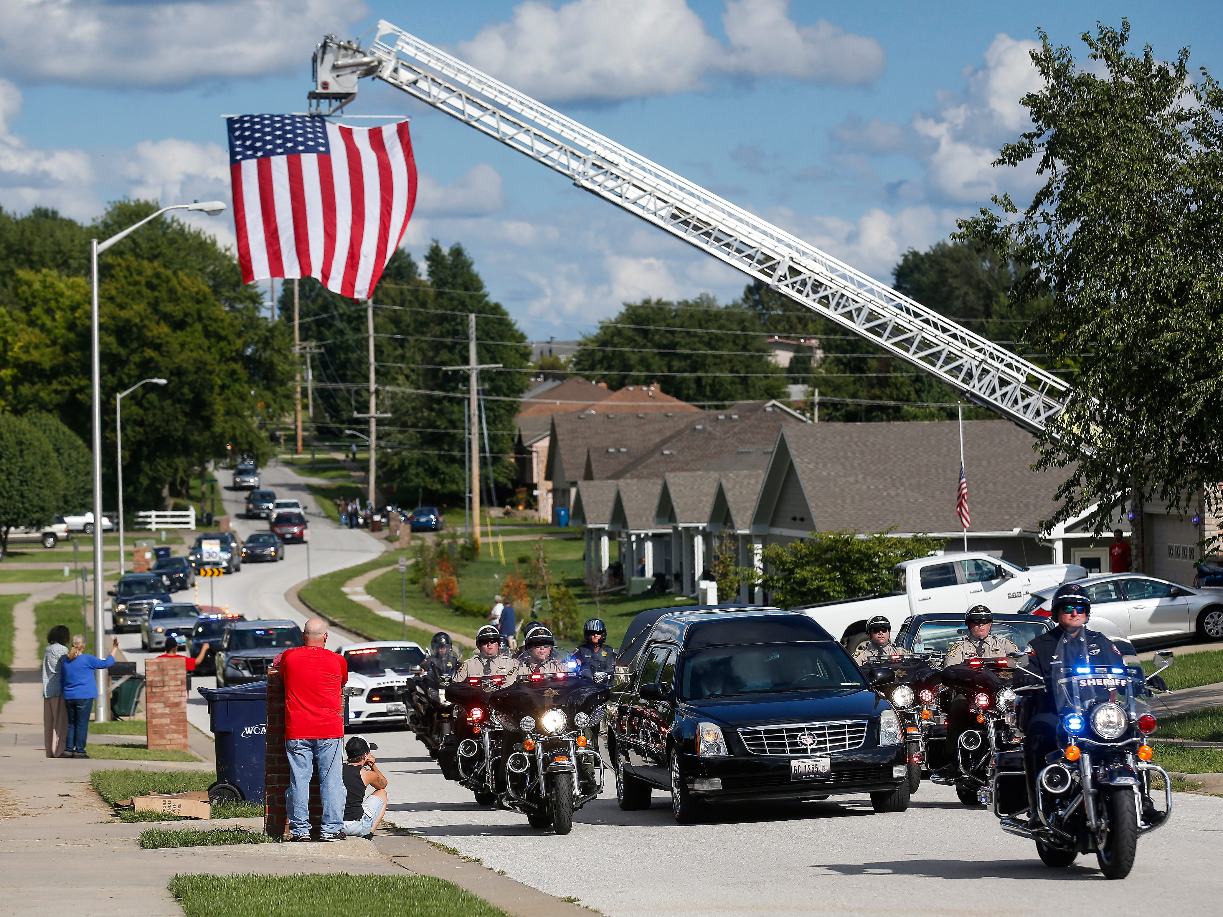The funeral procession for Deputy Aaron Roberts moves down McClernon Street on Thursday, Sep. 13, 2018.
