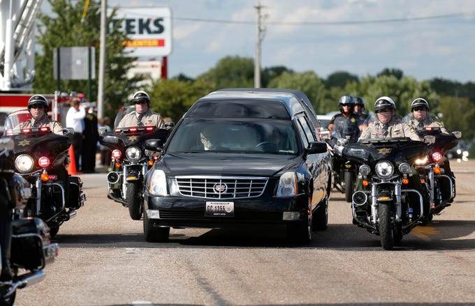 A hearse carrying Deputy Aaron Roberts moves down Glenstone Avenue on Thursday, Sep. 13, 2018.