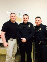 Aaron Roberts (center) with colleagues at the Willard Police Department.