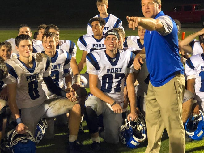 Fort Defiance's Bryce Owens (center) joins the team in listening to head coach Dan Rolfe speak to them following their win over Wilson Memorial in a game played in Fishersville on Wednesday, Sept. 12, 2018.