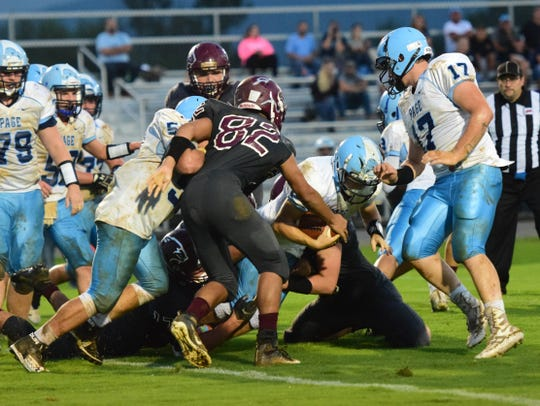Stuarts Draft's defense stops Page County's Mikey Cash during the second quarter of their Shenandoah District football game on Wednesday, Sept. 12, 2018, at Stuarts Draft High School in Stuarts Draft, Va.