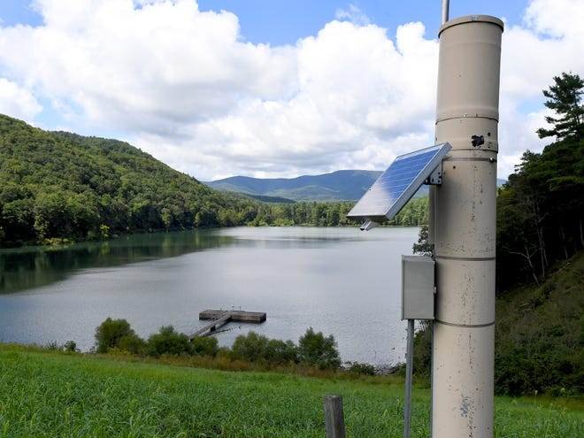 The Integrated Flood Observing and Warning Systems (aka. IFLOWS) gauge overlooks Elkhorn Lake from its place on top of the dam at the location.
