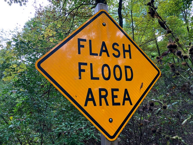 A sign along the road leading to Elkhorn Lake warns that the area is a flash flood area.