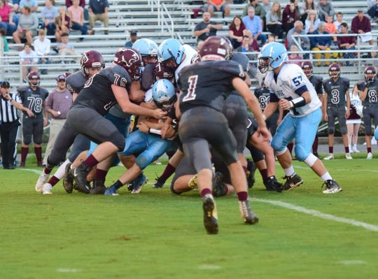 Stuarts Draft's defense envelopes a Page County ball carrier during their first quarter of their Shenandoah District football game on Wednesday, Sept. 12, 2018, at Stuarts Draft High School in Stuarts Draft, Va.
