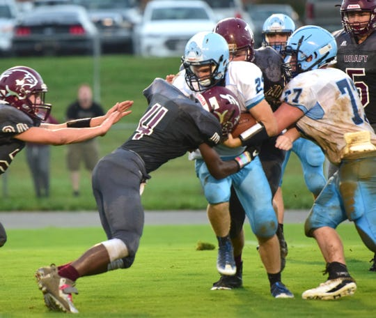 Stuarts Draft's Jo'el Howard stops Page County's Clay Seal during the second quarter of their Shenandoah District football game on Wednesday, Sept. 12, 2018, at Stuarts Draft High School in Stuarts Draft, Va.