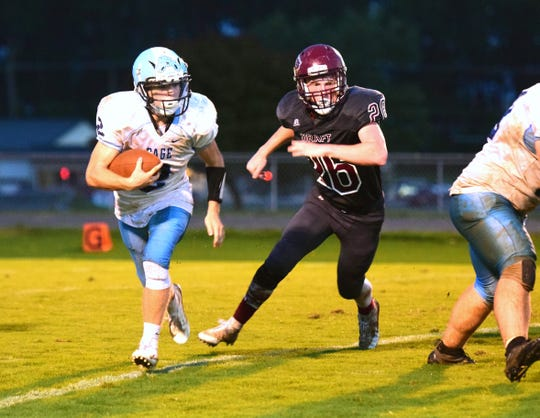 Stuarts Draft's Jesse McCauley pursues Page County's Mikey Cash during the second quarter of their Shenandoah District football game on Wednesday, Sept. 12, 2018, at Stuarts Draft High School in Stuarts Draft, Va.