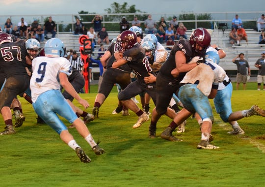 Stuarts Draft's Aaron Nice races through the Page County defense during the first quarter of their Shenandoah District football game on Wednesday, Sept. 12, 2018, at Stuarts Draft High School in Stuarts Draft, Va.