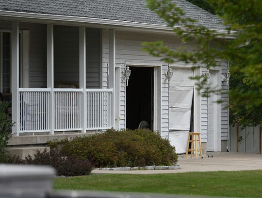 Damage to a garage door is visible on the home where officers responded to the scene of a shooting Thursday, Sept. 13, in Sauk Centre.