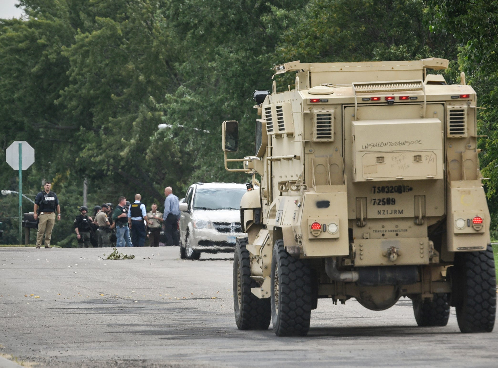 An armored vehicle approaches the scene where a Stearns County deputy was shot with an arrow Thursday, Sept. 13, in Sauk Centre. A suspect was taken into custody after a two-hour standoff.