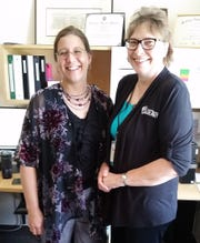 Karen Pundsack and Peggy Aschenbrenner in Karen's GRRL office.