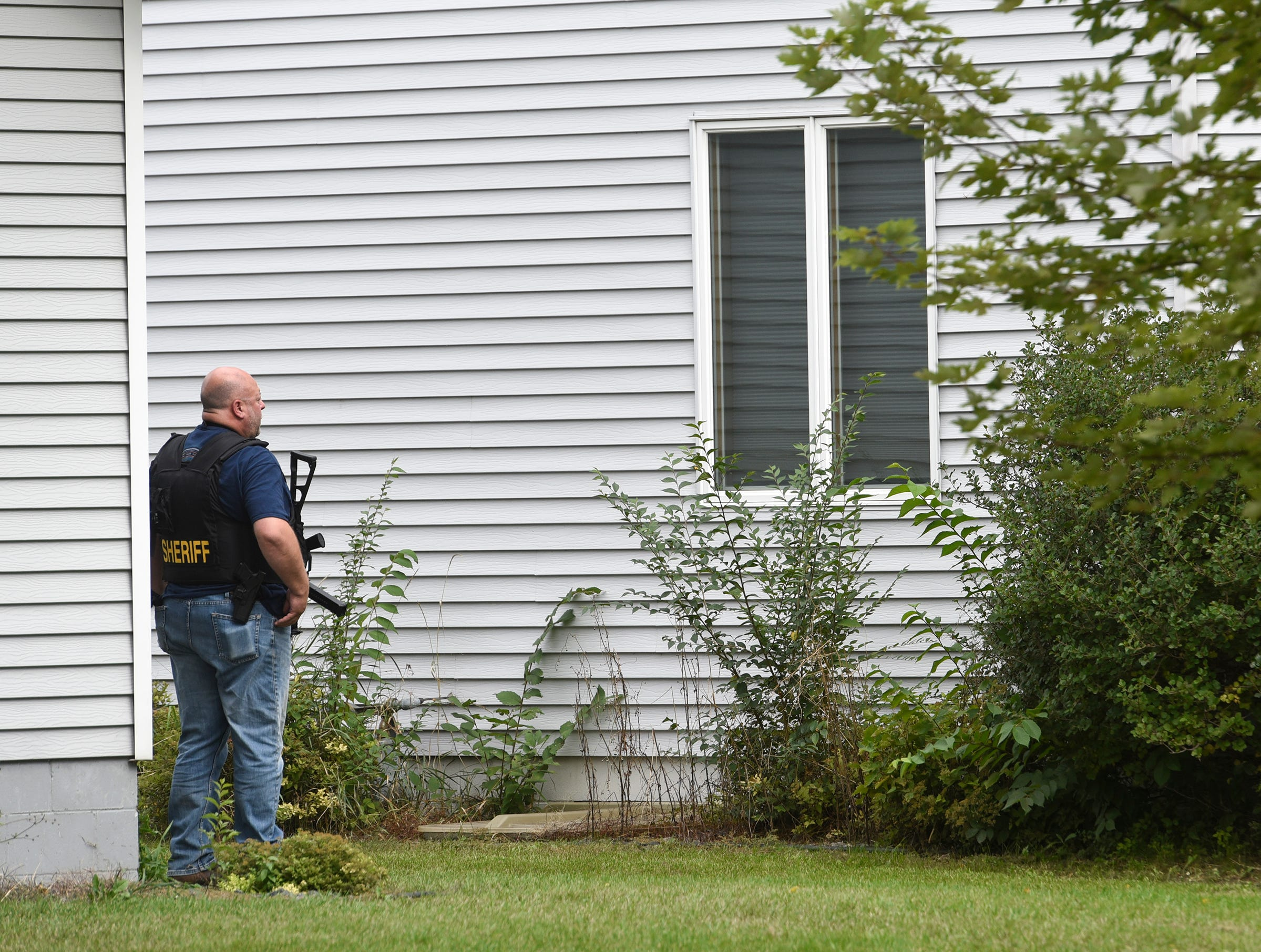 Officers remain on the scene here a Stearns County deputy was shot with an arrow after the suspect was removed from the house Thursday, Sept. 13, in Sauk Centre.