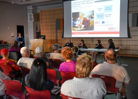 Attendees listen to the panel of speakers during an AARP discussion on elder abuse legislation Wednesday, Sept. 12,  at the Great River Regional Library in St. Cloud.