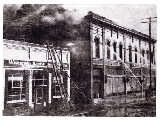A fire destroyed the Nash Block on April 23, 1937. This photo was taken along First Avenue, showing the Wisconsin Rapids Daily Tribune and Montgomery Ward.