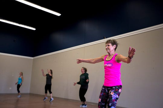 Betty Lou Sweeney, right, warms up before an interval training workout at Forever Fit in Plover, Wis., September 12, 2018.