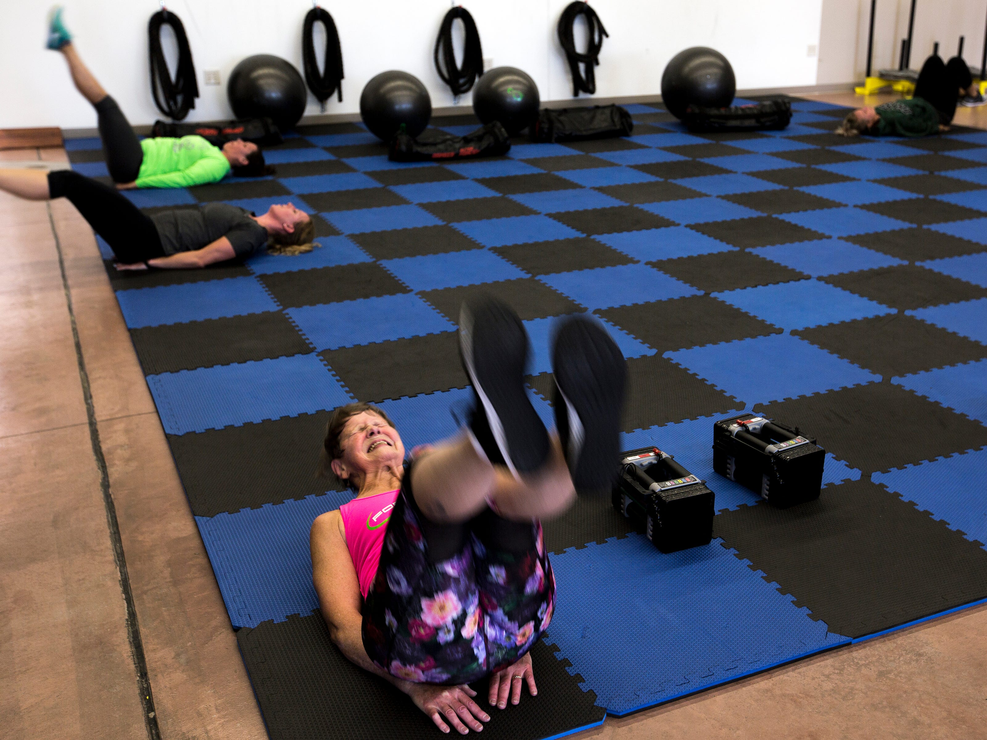 Betty Lou Sweeney does ab excercises near the end of an interval training class at Forever Fit in Plover, Wis., September 12, 2018.
