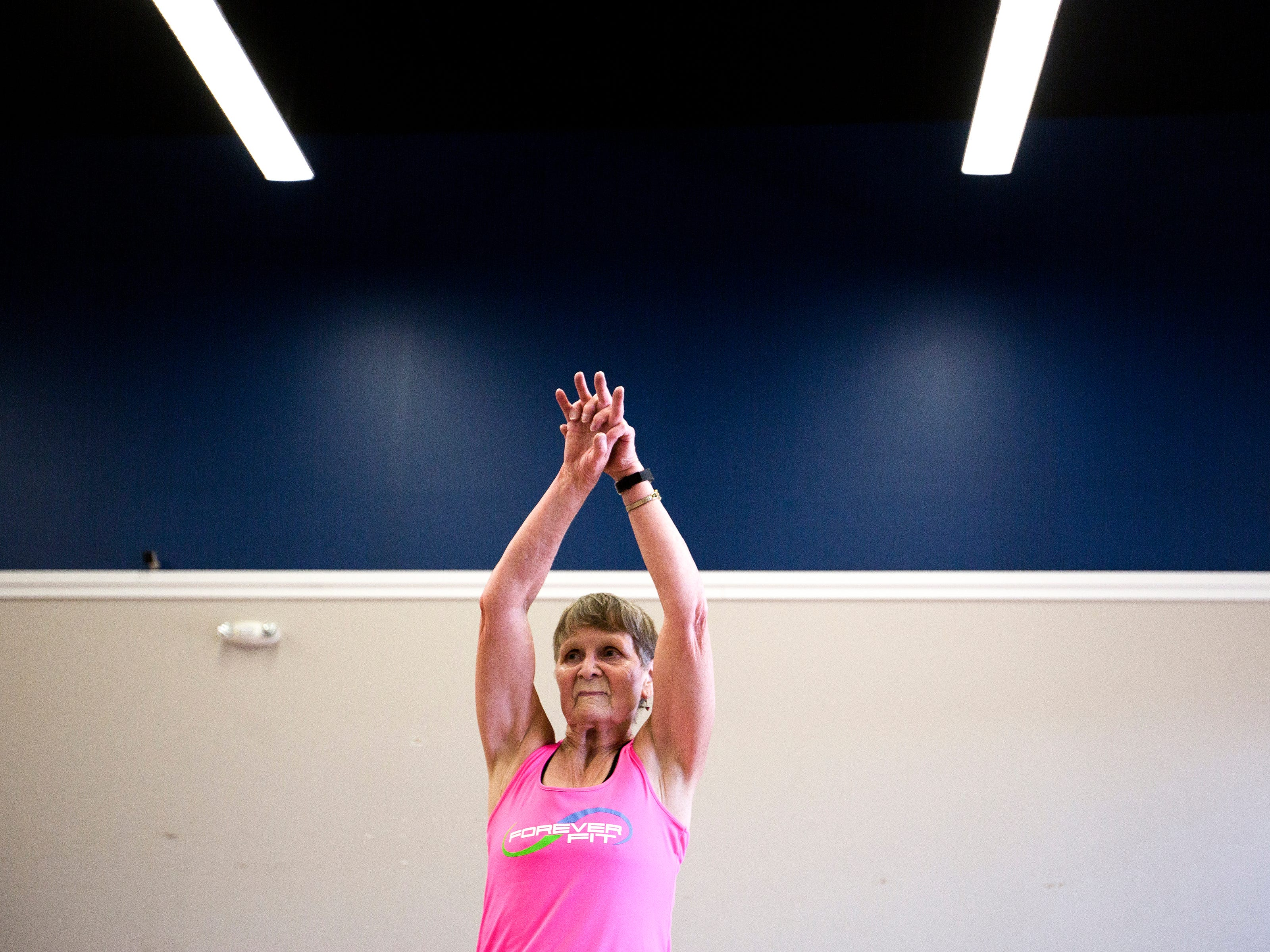 Betty Lou Sweeney stretches before an interval training workout at Forever Fit in Plover, Wis., September 12, 2018.