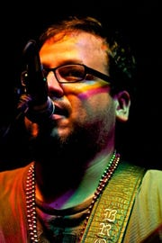 Brown Kid performs acoustic beach music at 8 p.m. Thursday at Blue Tavern.