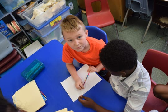 Josiah Monday (left) creates a plan for a paper tower with Kingston Kimbrough during a gifted and talented class on Thursday, Sept. 6, 2018 at Sealey Elementary School.